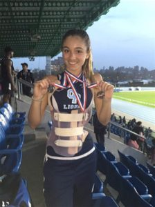 Kate with her medals and Rigo brace